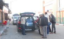 تقديم مساعدات غذائية للمتواجدين بالحجر الصحي في وسط قطاع غزة