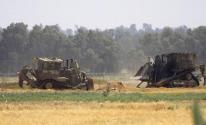 الجرافات لاحتلال على حدود غزة