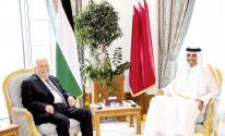 عباس والشيخ تميم