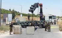 الاحتلال يغلق حي الشيخ جراح بالمكعبات الاسمنتية.jpg