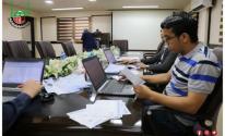 غرفة تجارة وصناعة غزة تستلم دفعة جديدة من تصاريح التجار.jpg