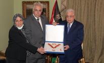 الرئيس محمود عباس وعائلة الكاتب الصحفي الراحل مكرم محمد أحمد