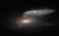 اندماج مجرتين سويا في ظاهرة تحدث مرة كل ملايين السنين