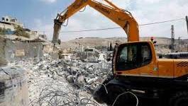 أرشيف - جرافات الاحتلال تهدم مغسلة سيارات