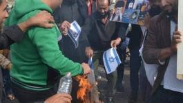عراقيون يحرقون علم إسرائيل  2.jpg