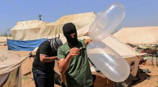 إصابة شاب جراء استهداف طائرات الاحتلال لمطلقي البالونات الحارقة شمال القطاع.jpg