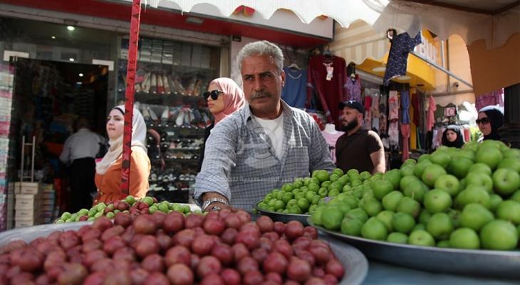 """شاهد: عدسة وكالة """"خبر"""" ترصد أجواء قبل الإفطار في أسواق رام الله"""