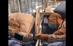 """بالفيديو والصور: زوجان مسنان يودعان بعضهما """"درامياً"""" في مستشفى صيني"""