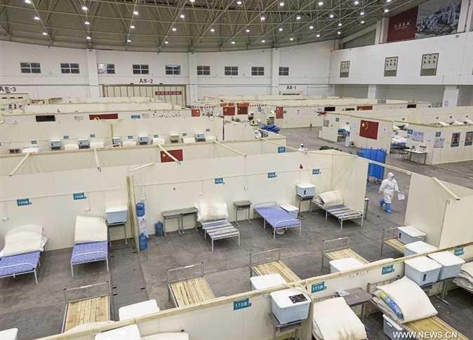 """مشهد غير مألوف.. إغلاق مستشفى بالصين بعد تراجع عدد وفيات فيروس """"كورونا"""""""