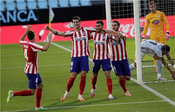 بالصور : سيلتافيجو يفاجىء اتلتكو مدريد ويوقف تقدمه